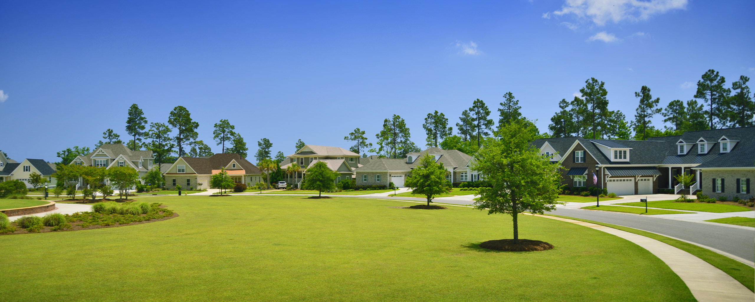Green parks within the community of Brunswick Forest.