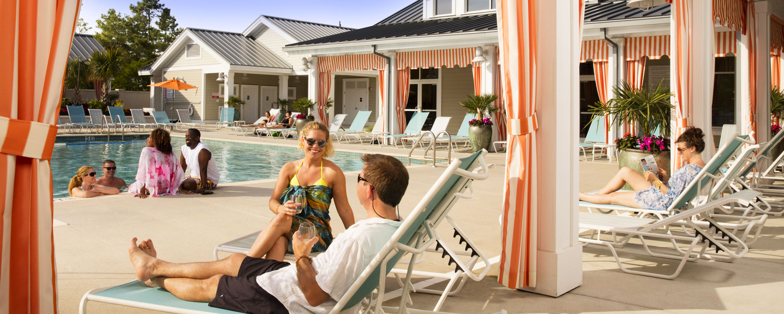 Brunswick Forest poolside view of residents enjoying the cabana