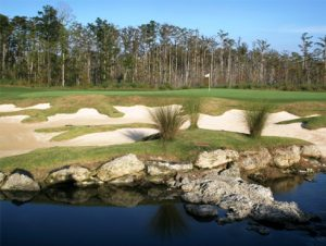 Water hazard and sand traps off the green