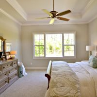 A guest bedroom in the Mango Bay at Brunswick Forest