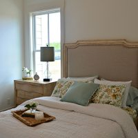 A guest bedroom in the Cooper at Brunswick Forest