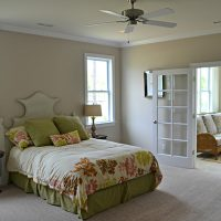 A bedroom of the Summerwind Villas at Brunswick Forest