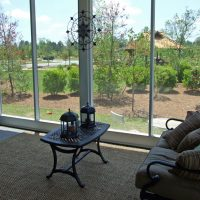 The screened porch on the Mather Green at Brunswick Forest