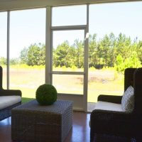 The screened porch on the Plum Island at Brunswick Forest
