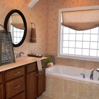 The large master bathroom in the St. Thomas at Brunswick Forest