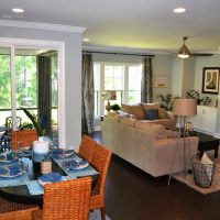 The dining nook into the family room in the Heron II at Brunswick Forest