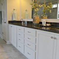The double vanity in the master bath of the Blue Heron II at Brunswick Forest
