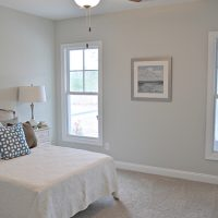A guest bedroom in the Blue Heron II at Brunswick Forest