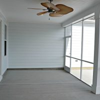 The screened porch of the Hamilton Bay at Brunswick Forest