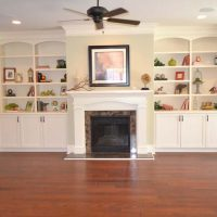The family room fireplace and shelves of the Egret at Brunswick Forest